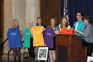 "IHSPA student officers display Mary Beth Tinker's more comical First Amendment shirts that coincide with their speech topics: Lauren Lecy, Chesterton High School (Speech); Ashley Shuler, Ben Davis High School (Petition); Nike Jordan, Portage High School (Assembly); Michelle Roberts, Greenwood High School (Religion); and Carley Lanich, Lawrence Central High School (Press). When keynote speaker Mary Beth Tinker and Mark Tague, Carmel High School, realize that the person who provides the introduction to the evening doesn't get a shirt they encourage Carley Lanich to share Freedom of the Press. Tinker, the popular icon of student expression, inspired students to ""stand up and speak up"" and stayed after the event to talk to students who wanted to meet her."
