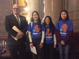 From left to right: John Williams, Carmel High School principal; Carmel students Selena Qian, Angela Quan and Lin-Lin Mo.